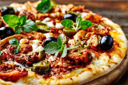 Chicken Gyro Pizza jalapeno pepper, black olives and fresh gerbs. Close up. Reklamní fotografie