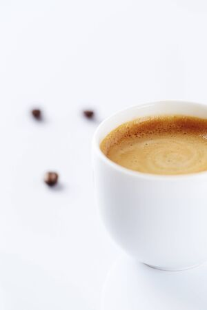 Cup of coffee on white background. Copy space.