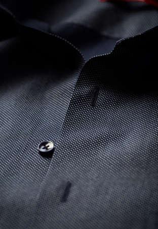 Close up of dark Men's shirt. Фото со стока