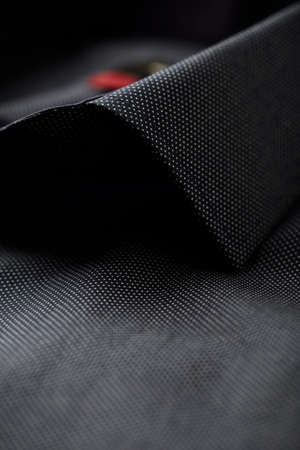 Close up of dark Men's shirt. Foto de archivo