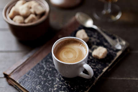 Cup of coffee on rustic wooden background. Close up. Foto de archivo