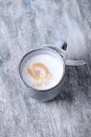 Coffee with milk. Wooden background. Close up. Copy space.