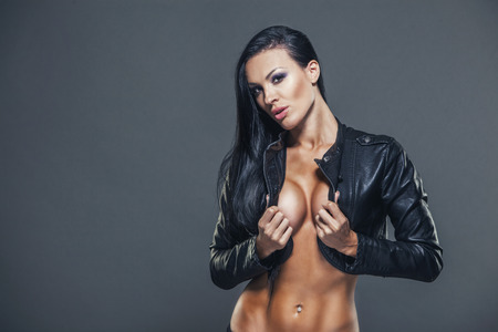 sexy breasts: Beautiful girl with sexy breasts in unbuttoned jacket with long black hair.