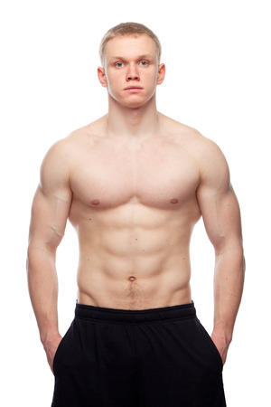 Image of muscle man posing in studio. Stock Photo