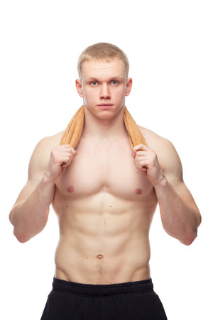 handsome young athletic: Happy muscular guy with towel over white background.