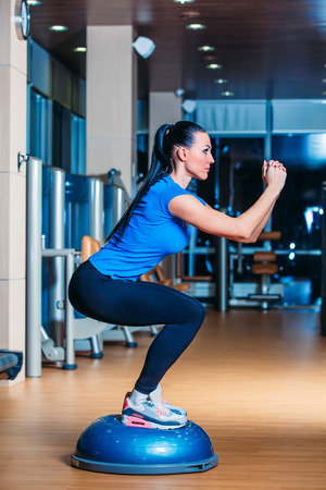 muscle formation: Young woman performing Step aerobics exercises in the gym Stock Photo