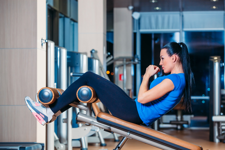 fitness, sports, training, technology and vision for the future lifestyle - smiling woman with the implementation of the simulator exercises in the gym