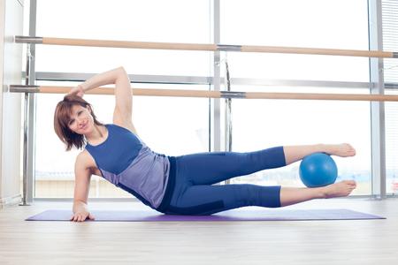 pilates ball: pilates woman stability ball gym fitness yoga exercises girl