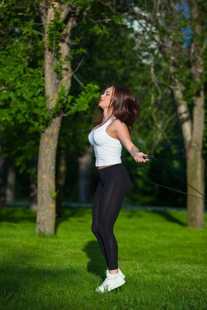 skipping rope: Sport, activity. Cute woman with skipping rope Stock Photo
