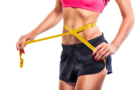 Weight losing - measuring womans body, isolated centimeter