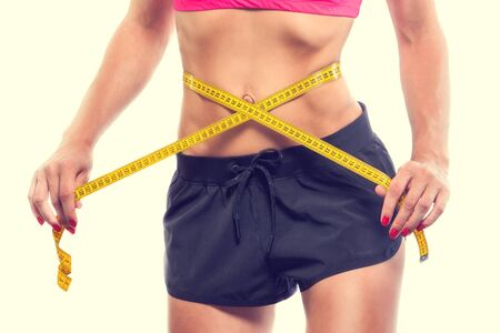 cuerpo femenino perfecto: Weight losing - measuring womans body, isolated centimeter