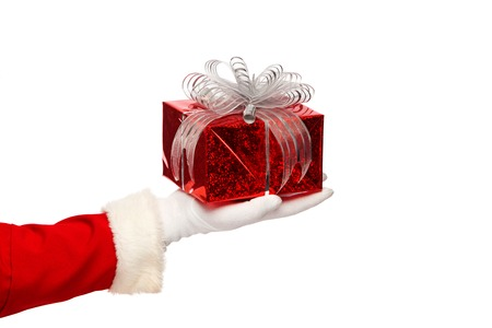 Santa claus giving christmas present box on a white background