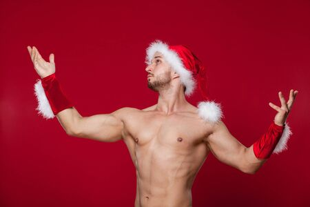red christmas backgrounds: muscular man in santa hat