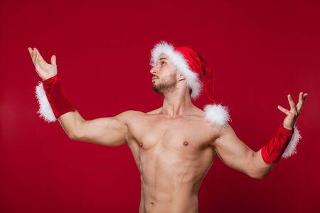 sunburnt: muscular man in santa hat