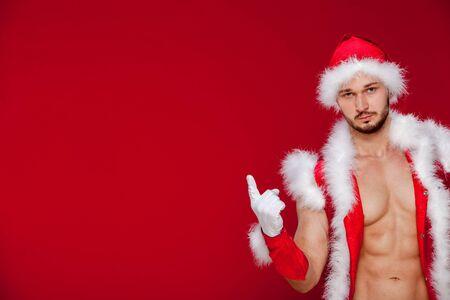 nude caucasian: muscular man in santa uniform Stock Photo