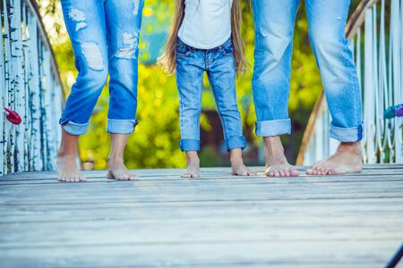 little girl barefoot: Happy Family on a Walk in Summer