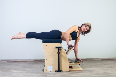 woman in yoga gym exercise. Stock Photo