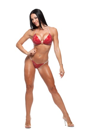 sexy legs: Full length photo of sporty woman in bikini isolated against white background. Stock Photo