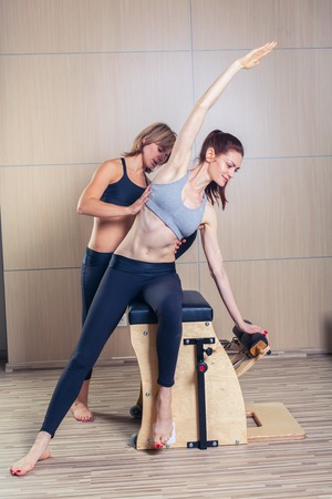 combo wunda pilates chair woman with instructor fitness yoga gym exercise