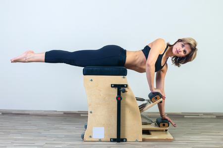 enceinte: combo wunda pilates chair woman fitness yoga gym exercise. Stock Photo