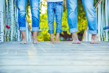 child feet: Happy Family on a Walk in Summer. Child with Parents Together. Feet Barefoot . Healthy Lifestyle. Dad Mom and Son. Spring Time. Stock Photo