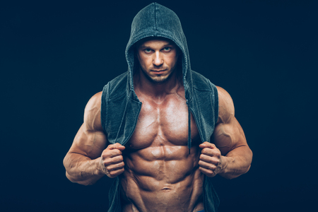 sexy food: Man with muscular torso. Strong Athletic Man Fitness Model Torso showing six pack abs