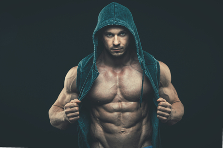 male arm: Man with muscular torso. Strong Athletic Man Fitness Model Torso showing six pack abs