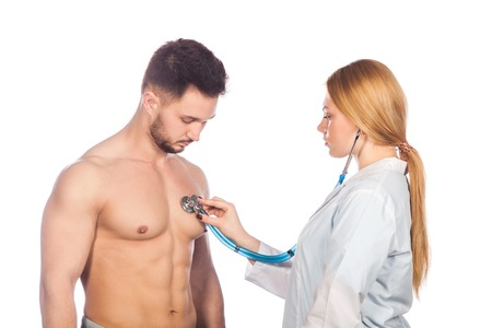 stethoscope: Doctor listening to young patient chest with stethoscope in his office at the hospital