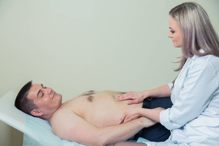 old man on a physical pressure: Doctor examining old patient lymph glands, throat inflammation Stock Photo