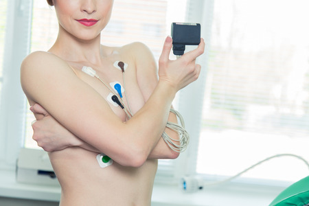Young woman wearing a Holter Heart Monitor.