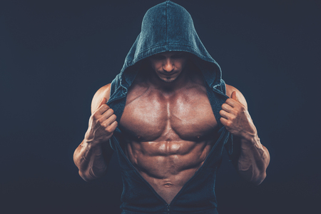 strong women: Man with muscular torso. Strong Athletic Man Fitness Model Torso showing six pack abs fighter  kickbox boxer boxing fight Stock Photo