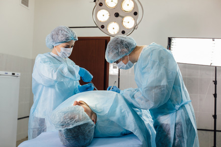 bioclean: Surgeons team working with Monitoring of patient in surgical operating room