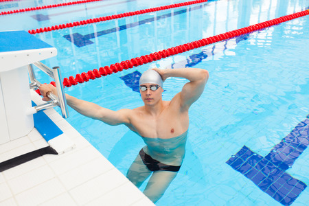 backstroke: Young man in a pool - go to start swimming. backstroke during.