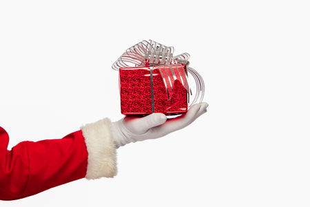 xmass: christmas Santa claus giving christmas present box on a white background, isolated.