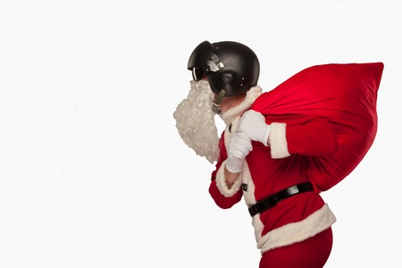 Cool Santa Claus with a bag of gifts in a Jets helmet. White background Stock Photo
