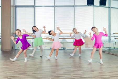 happy children dancing on in hall, healthy life, kids togetherness and happiness concept.
