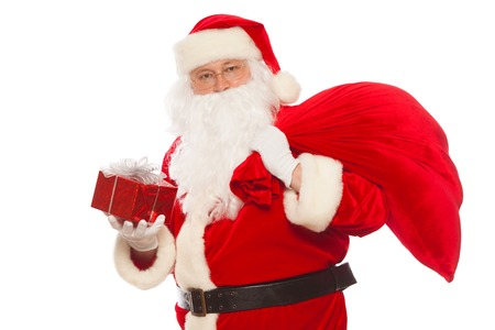 xmass: Santa Claus: Cheerful With Small Stack Of Gifts big bag, isolated on white background Christmas