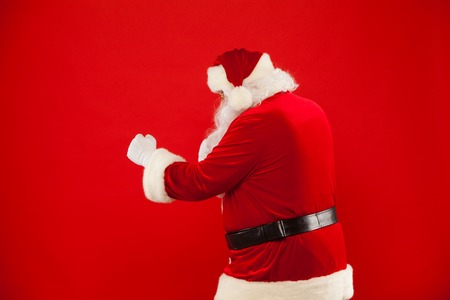 Santa Claus is preparing for fight. red background