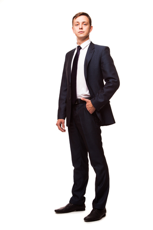Stylish young man in suit and tie. Business style. Handsome man standing and looking at the camera Stock Photo