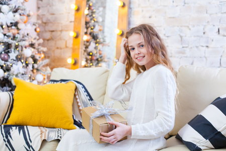 Happy little smiling girl with christmas gift box Archivio Fotografico