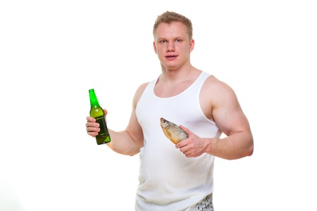 Fat man with a bottle of beer and fish isolated on white.Portrait of overweight person who spoiled healthy meal . Junk meal leads to obesity. Disruption from diet concept. He is trying to go on a diet.