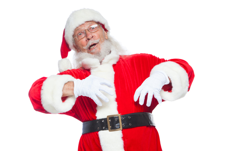 Christmas. Good Santa Claus in white gloves shows faces, grimaces, shows his tongue. Not standard behavior. Isolated on white background.