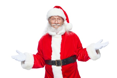 Christmas. Sales, marketing, discount, advertising, gifts. Santa Claus gestures with his hands as if he is holding something and has to choose between two options. Isolated on white background. Standard-Bild