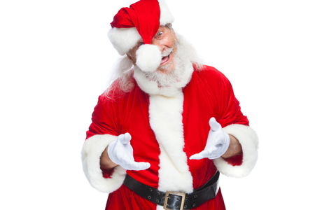 Christmas. Santa Claus fooling around with a boombox hat. Ridiculous-looking, tongue out. Isolated on white background. Stock Photo