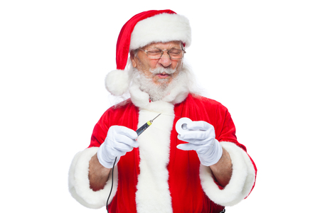 Christmas. Santa Claus in white gloves holding a soldering iron with a solder. Electronics, equipment repair.
