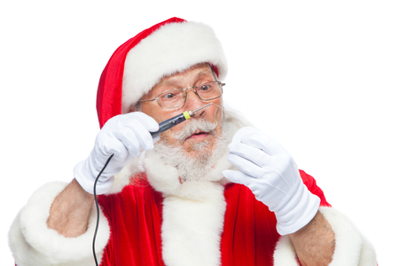 Christmas. Santa Claus in white gloves holding a soldering iron with a solder. Electronics, equipment repair. Ad of a master on equipment repair. Isolated on white background.