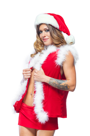 Christmas. Beautiful muscular sexual happy woman in Santa Claus clothes. Isolated on white background. Stock Photo