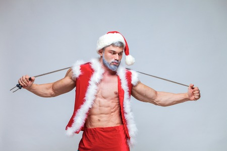 Sport, activity. Sexy Santa Claus with skipping rope. Young musc