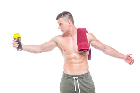 Muscular man drinking water with red towel over neck, isolated on white background