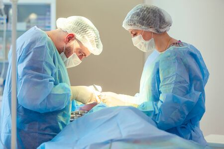 Medical Team Performing Surgical Operation in Modern Operating Room. Rhinoplasty